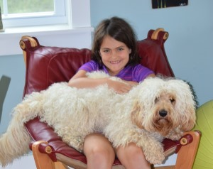 girl with labradoodle on her lap